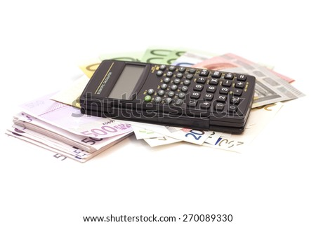 Calculator with euro bank notes isolated on white - stock photo