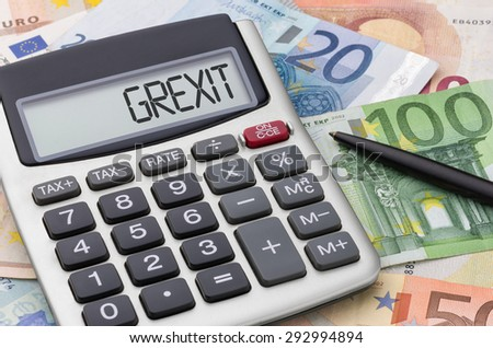 Calculator with euro bills - Grexit - stock photo