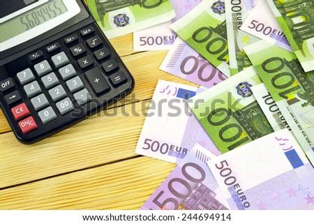 Calculator with euro money   - stock photo