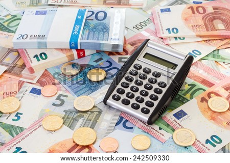 Calculator with Euro notes and coins. Finance concept. - stock photo