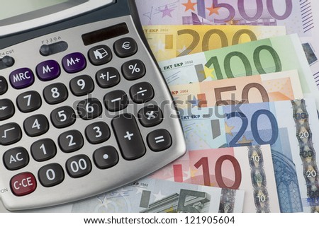 Calculator with euro notes. Background with euro banknotes and calculator - stock photo