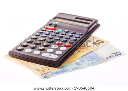 Calculator with fifty and twenty Euro Bill on white Background / calculation - stock photo
