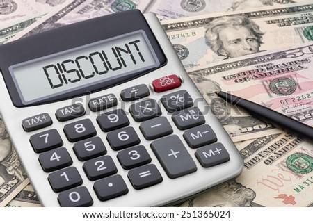 Calculator with money - Discount - stock photo