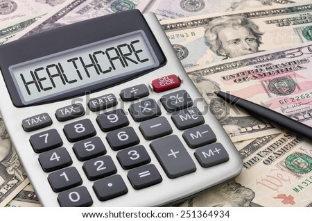 Calculator with money - Healthcare - stock photo
