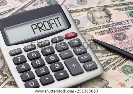 Calculator with money - Profit - stock photo