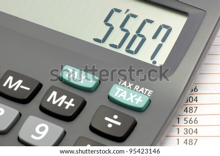 Calculator with numbers superimposed on the price list. - stock photo