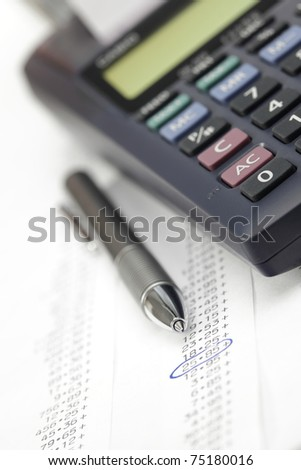 Calculator with pen and adding machine tape