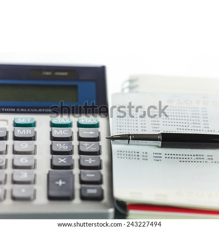 Calculator with Pen on bank account passbook