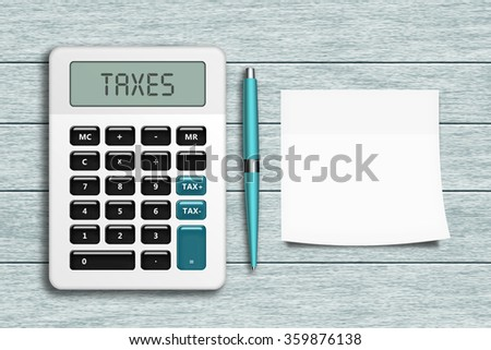 calculator with taxes text, pen, and empty note lying on wooden desk  - stock photo