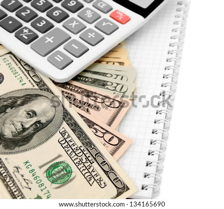 Calculators and dollars on a notebook. - stock photo