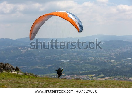CALDELAS, PORTUGAL - JUNE 4: Paragliding Festival Aboua Cup de Caldelas 2016, in the north of Portugal, 4 June, 2016, Caldelas, Portugal. - stock photo