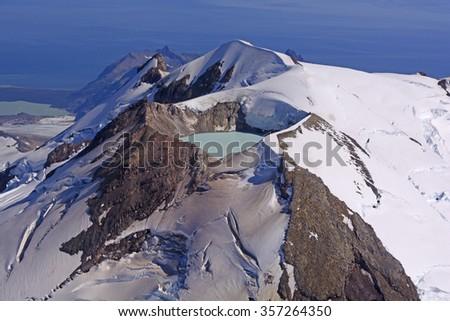 Caldera Lake in an Active Volcano on Mount Douglas in the Alaska Peninsula of Alaska - stock photo