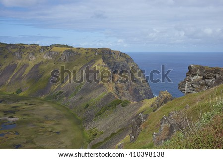 Caldera of the extinct volcano Rano Kau within the UNESCO World Heritage Site of Rapa Nui National Park on Easter Island. - stock photo