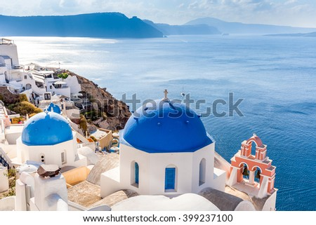 Caldera view and blue domes, Santorini island, Greece - stock photo