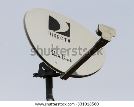 CALDWELL, ID/USA - OCTOBER 22, 2015: DirecTV satellite dish installed on a roof getting a signal - stock photo