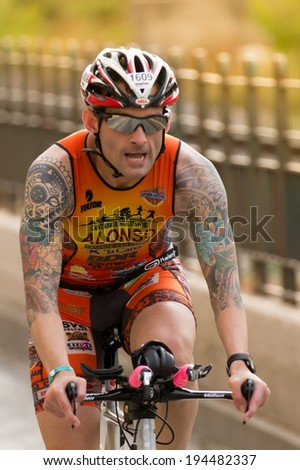 CALELLA, SPAIN MAY 18:  Triathlete rides speed cycle on the Ironman triathlon competition at Calella beach, May 18, 2014 in Calella, Spain