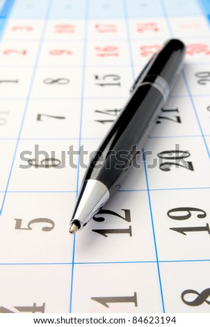 calendar and a pen are shown in close-up