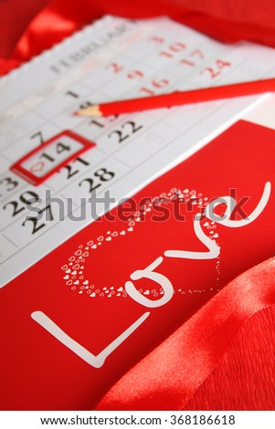 Calendar, day marked by February 14. background - stock photo