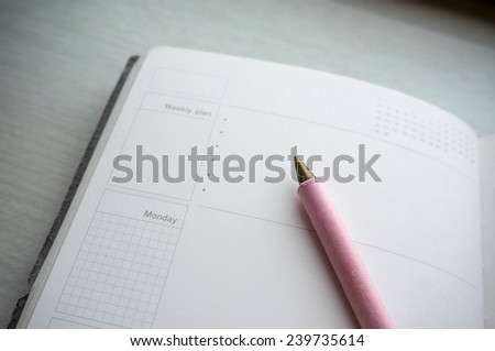 Calendar / day planner diary with pen on open page - stock photo