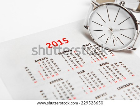 Calendar for 2015 and a wristwatch - stock photo