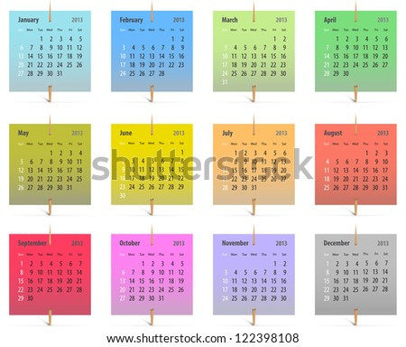 Calendar for 2013 on colorful stickers attached with toothpicks - stock photo