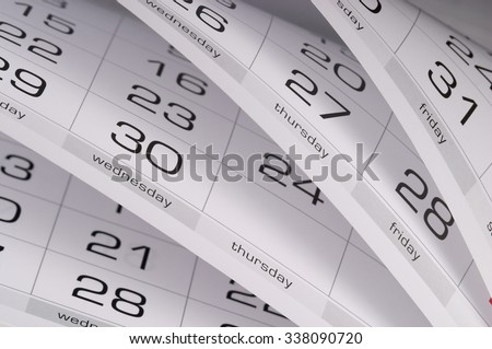 Calendar fragment perspective shot with partial blurred areas - stock photo
