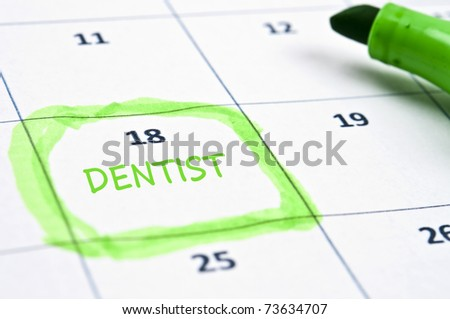 Calendar mark  with Dentist - stock photo
