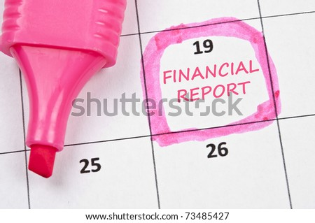 Calendar mark with financial report - stock photo
