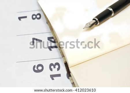 Calendar, notebook, pen