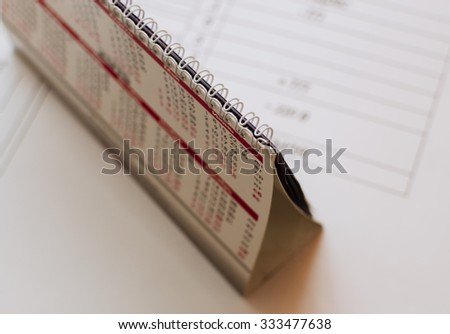 Calendar on the white paper with any project in the office, with selective focus - stock photo