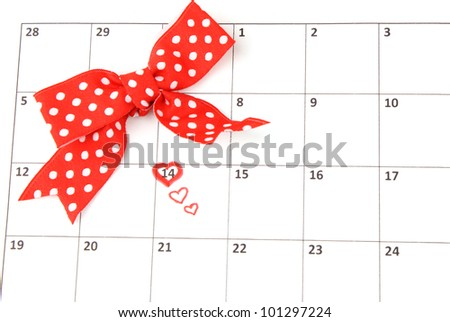 Calendar page with hearts and bow on St.Valentines Day - stock photo