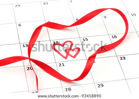 Calendar page with hearts and ribbon on St.Valentines Day - stock photo