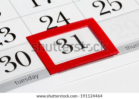 Calendar page with marked date of 31st - stock photo