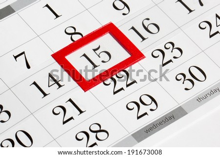 Calendar page with marked date of 15th - stock photo