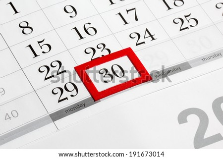 Calendar page with marked date of 30th - stock photo
