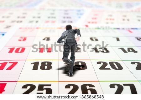 Calendar, Running businessman - stock photo