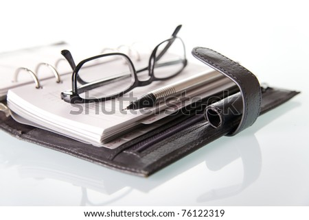 Calendar with pencil and glasses