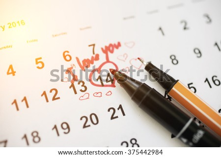 Calendar with the date of February 14 Valentine's day with red heart mark