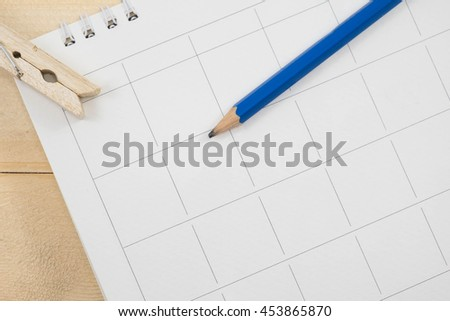 calender date and pencil on wooden background - stock photo