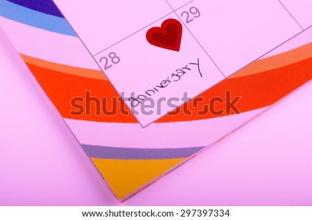 Calender page with a heart - stock photo