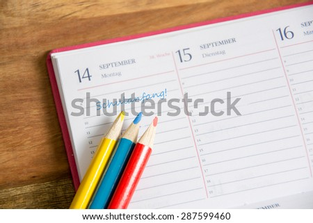 Calender showing first day of school - stock photo