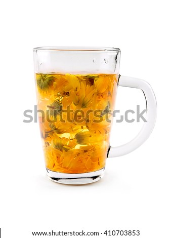 Calendula dry flower tea in glass cup  on the white background. Calendula or marigold decoction