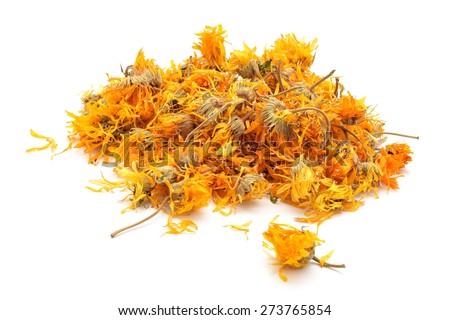 Calendula officinalis or Marigold dry tea flowers - stock photo