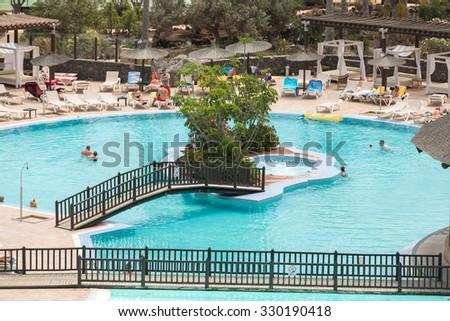 CALETA DE FUSTE, SPAIN - SPETEMBER 7, 2015: Swimming Pool in Caleta de Fuste on Fuerteventura . Canary Island. Spain - stock photo