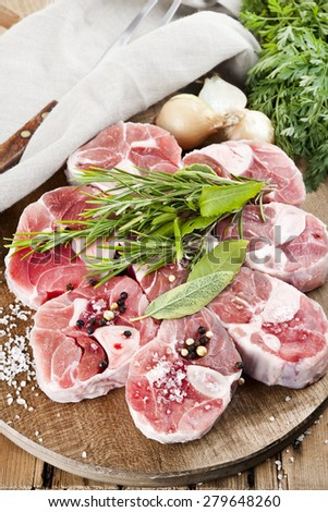 calf meat ossobuco, pig meat ossobuco, organic, bio, raw preparation,restaurant food  - stock photo