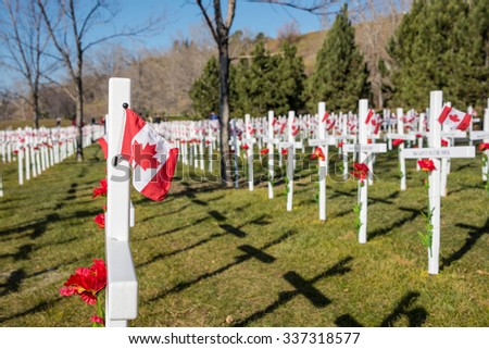 Calgary, Alberta November 8, 2015 - Thousands of crosses lined up row by row along Memorial Drive to commemorate the fallen Canadian soldiers that died in battle, located in Calgary, Alberta, Canada.