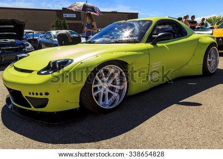 """CALGARY CANADA AUG 9 2015: """"Hot Import Nights"""" car show , the show is a regular event held each year in Calgary and Vancouver, where specialized imported vehicles on display by the owners.  - stock photo"""