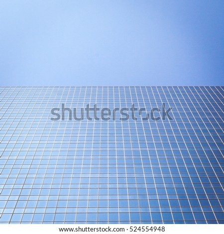 CALGARY, CANADA - 8 AUGUST 2009: Abstract vertical, low angle view of the side of a modern skyscraper in downtown Calgary, Alberta, Canada.