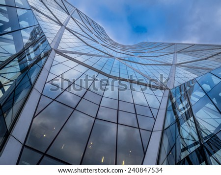 CALGARY, CANADA - DEC 22: The Bow Tower on December 22, 2014 in Calgary, Alberta Canada. The Bow is the newest and tallest skyscraper in Canada outside Toronto and home to Encana and Cenovus.  - stock photo