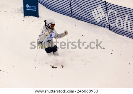CALGARY CANADA JAN 3 2015. FIS Freestyle Ski World Cup, Winsport, Calgary Ms. Jee-Won Seo  from Korea at the Mogul Free Style World Cup on race day.